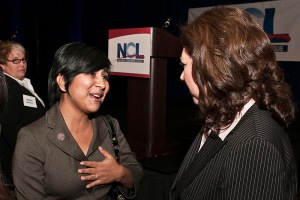 Norma Flores (left) speaks with Labor Secretary Hilda Solis at the 2009 Trumpeter Awards Dinner.
